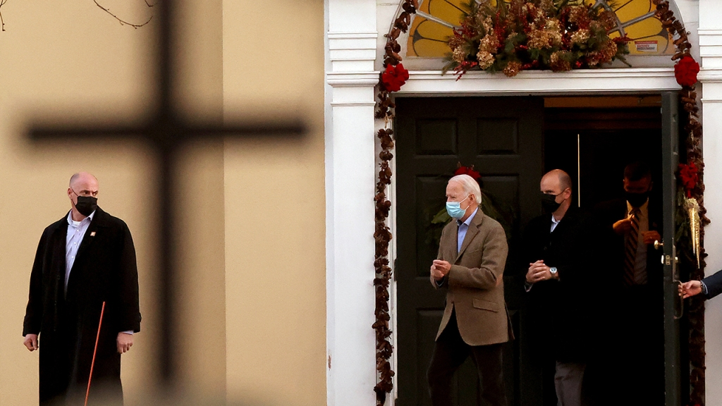 Shadowed by his security detail, then U.S. President-elect Joe Biden leaves St. Joseph's on the Brandywine Roman Catholic church in January 2021, where his family regularly attends services. (Chip Somodevilla/Getty Images)